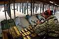 U.S. Air Force Staff Sgt. Kenvyn Lewis, right, a combat arms instructor with the 169th Security Forces Squadron, South Carolina Air National Guard, instructs Airmen on the firing range during M4 carbine 131208-Z-WT236-023.jpg