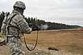 U.S. Army Sgt. 1st Class Jose Mejia, assigned to the 615th Military Police Company, 18th MP Brigade, fires an M203 grenade launcher practice round down range at the 7th Army Joint Multinational Training 140116-A-BS310-137.jpg