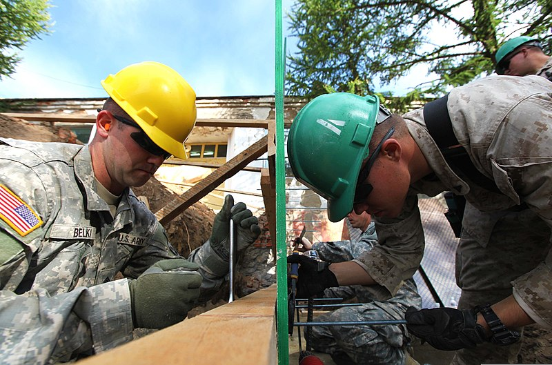 File:U.S. Army Sgt. Sean Belka, left, an interior electrician with ...