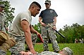 U.S. Army Spc. Jesse Rameriz, center, with Headquarters and Headquarters Company, 105th Military Police Battalion, North Carolina Army National Guard, completes a defense course during oleoresin capsicum 130501-Z-AY498-009.jpg