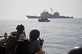 U.S. Coast Guardsmen with Maritime Safety and Security Team 91104 and visit, board, search and seizure team members approach a rigid-hull inflatable boat during a simulated boarding in the Gulf of Aden near 090826-N-ZL677-052.jpg
