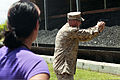 U.S. Marine Corps Staff Sergeant Nathan J. Knuckles a Training Chief with Provost Marshall Office, Service Company, Headquarters Battalion (HQBN), demonstrates the proper way to handle the Berretta M9 9mm 130524-M-BN443-015.jpg