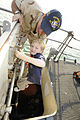 U.S. Navy Lt. Mat Rechkemmer, top, the executive officer of coastal patrol ship USS Whirlwind (PC 11), helps a Cub Scout out of a hatch during a tour of the ship at Mina Salman Pier, Manama, Bahrain, Jan. 7 120107-N-OX597-185.jpg