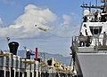 U.S. Sailors aboard the littoral combat ship USS Freedom (LCS 1), right, throw a line as the ship arrives for a scheduled port visit March 11, 2013, at Joint Base Pearl Harbor-Hickam, Hawaii 130311-N-RI884-131.jpg