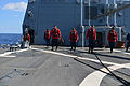 U.S. Sailors conduct a foreign object damage walk Aug. 7, 2013, before flight operations on the flight deck of the guided missile destroyer USS Truxtun (DDG 103) in the Atlantic Ocean 130807-N-YZ751-053.jpg