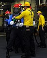 U.S. Sailors practice firefighting techniques during a general quarters training exercise aboard the aircraft carrier USS George H.W. Bush (CVN 77) in the Atlantic Ocean May 20, 2013 130520-N-CZ979-257.jpg