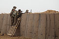 U.S. Soldiers and Afghan soldiers provide security while standing behind HESCO barriers during strongpoint construction at Zharay district, Kandahar province, Afghanistan, Feb 120210-A-QD683-134.jpg