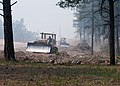 U.S. Soldiers with the 497th Engineer Company, 52nd Engineer Battalion, 555th Engineer Brigade use bulldozers to move flammable debris in response to the Black Forest Fire June 13, 2013, in Colorado Springs 130613-A-UK001-187.jpg