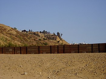 US-Mexico border barrier near Monument Road, S...