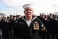 US Navy 012409-N-5191L-036 A Sailor assigned to the amphibious transport dock ship USS Green Bay (LPD 20) stands at parade rest awaiting the call to man the rails and bring the ship to life.jpg