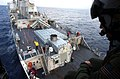 US Navy 021029-N-3235P-520 Hovering above USS Mitscher.jpg
