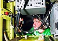 US Navy 021111-N-0050T-001 Photographer's Mate works on the Tactical Air Reconnaissance Pod (TARPS) systems Power Distribution Unit (PDU).jpg