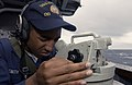 US Navy 030816-N-2613R-006 Seaman Mario Smith, from Gulfport Miss., takes a bearing on a target during a rescue at sea drill aboard USS Cushing (DD 985).jpg