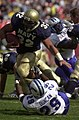 US Navy 031004-N-6157F-002 Navy Junior Fullback Kyle Eckel runs over Air Force Academy free safety Larry Duncan.jpg