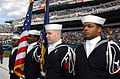 US Navy 041017-N-4729H-027 Sailors standby to parading the colors at opening ceremonies for a National Football League (NFL) game between the Philadelphia Eagles, and the Carolina Panthers at Lincoln Financial Field, Philadelph.jpg