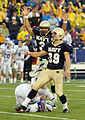 US Navy 051008-N-9693M-019 U.S. Naval Academy Midshipmen kicker Joey Bullen celebrates his game winning field goal with 4-10ths of a second left in the game against Air Force as Falcon defender Carson Bird (2) rolls out of the.jpg