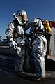 US Navy 051219-N-7241L-002 Damage Control Crash and Salvage team members don proximity suits in preparation for an emergency aircraft landing on the flight deck aboard the Nimitz-class aircraft carrier USS Theodore Roosevelt (C.jpg