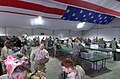US Navy 060119-N-8055R-001 Soldiers repack their bags after having them inspected in the Navy Customs baggage tent.jpg