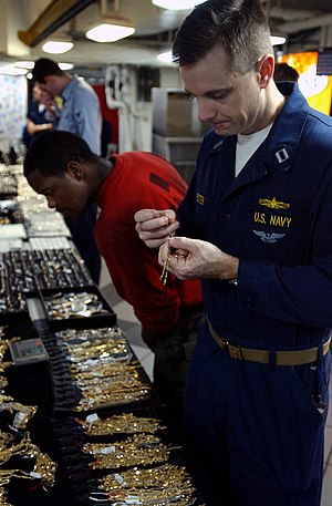 Buyer decision process - Making a few last minute decisions before purchasing a gold necklace from a Navy Exchange vendor