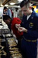 US Navy 060513-N-5174T-045 Lt. Taylor Forester makes a few last minute decisions before purchasing a gold necklace from a Navy Exchange vendor aboard the Nimitz-class aircraft carrier USS Ronald Reagan (CVN 76).jpg