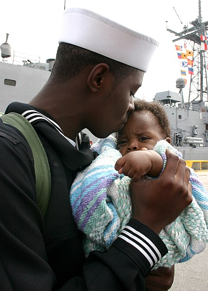 File:US Navy 070309-N-8544C-043 Seaman Brandon King Sr. embraces his five-month old son for the first time at the homecoming ceremony for guided missile frigate USS Taylor (FFG 50).jpg