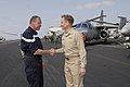 US Navy 070316-N-8157C-003 Commander, Task Force (CTF) 473, French Rear Adm. Xavier Magne, left, is greeted by Commander, Carrier Strike Group 3, Rear Adm. Kevin Quinn on the flight deck of Nimitz-class aircraft carrier USS Joh.jpg