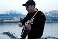 US Navy 070408-N-4124C-007 Ensign Alex Sicola, assigned to amphibious assault ship USS Essex (LHD 2), plays a hymn during a Sunrise Easter Service on the ship's flight deck.jpg