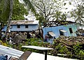 US Navy 070413-N-4790M-014 Residents try to salvage materials from houses destroyed by an earthquake and resulting tsunami.jpg