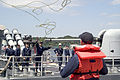 US Navy 070521-N-0483B-002 A Sailor aboard Pearl Harbor-based guided-missile cruiser USS Lake Erie (CG 70) tosses a line to another Sailor on the pier at Commander Fleet Activities Yokosuka.jpg