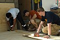 US Navy 070531-N-7029R-198 Sailors from partner nations build a stage for the kids at Michilla School during a community relations project during Teamwork South 2007.jpg