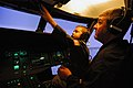 US Navy 071004-N-2183K-212 Father and son, fly an MH-60S Seahawk helicopter in a flight simulator at Helicopter Sea Combat Squadron (HSC) 23, on board Naval Air Station North Island.jpg