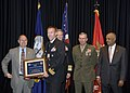 US Navy 071016-N-3557N-041 Secretary of the Navy (SECNAV), the Honorable Donald C. Winter presents Carrier Air Wing (CVW) 5 with the Large Deck Surface Combatant Team Safety Excellence Award.jpg