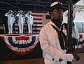 US Navy 080612-N-5240C-011 Aviation Support Equipment Technician 2nd Class Blossom Joseph, an honor guard assigned to Naval Air Station (NAS) Key West, parades the colors during a change of command ceremony.jpg