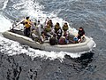 US Navy 080808-N-4431B-405 A Royal Brunei Navy visit, board, search, and seizure team waves to their counterparts aboard the amphibious dock landing ship USS Tortuga (LSD 46) after completing a joint training exercise.jpg