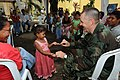 US Navy 080829-N-9774H-244 Cmdr. Donald Fix entertains a young child at San Cristobal Hospital.jpg