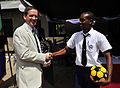 US Navy 081218-N-0506A-079 U.S. Ambassador to Tanzania, Mark Green, presents a student with a soccer ball.jpg