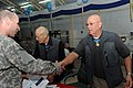 US Navy 090412-N-0636S-007 Retied Col. Robert L. Howard, left, and retired Command Sgt. Maj. Gary L. Littrell sign copies of their Medal of Honor citations for service members at Life Support Area, South West Asia.jpg