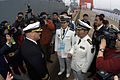 US Navy 090419-N-1251W-118 Cmdr. Richard Dromerhauser, commanding officer of the guided-missile destroyer USS Fitzgerald (DDG 62), speaks with officers of the People's Liberation Army Navy after Fitzgerald's arrival in the port.jpg