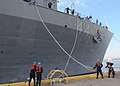 US Navy 100115-N-6764G-093 Line handlers remove mooring lines as the amphibious transport dock ship USS Gunston Hall (LSD 44) departs Joint Expeditionary Base Little Creek-Fort Story.jpg