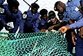 US Navy 100315-N-7948C-177 talian navy Lt. Federico Panconi shows an example of a properly constructed fishing net to Nigerian and Ghanaian sailors.jpg