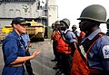 US Navy 100330-F-4109M-050 Capt. Cindy Thebaud talks to Ghana Sailors about their performance following a visit, board, search and seizure drill.jpg