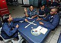 US Navy 100926-N-6632S-130 Sailors assigned to the aircraft carrier USS George H.W. Bush (CVN 77) play a game of dominos in the ship's galley.jpg