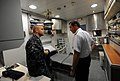 US Navy 101202-N-2984R-235 Adm. Edmundo Gonzales Robles speaks to Hospital Corpsman 1st Class Michael Loeffler inside the High Speed Vessel Swift (.jpg