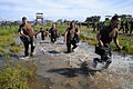 US Navy 110325-N-SI773-954 Sailors carry ammo cans through a four-pit run obstacle during the 2nd annual Vietnam-6 Memorial Super Squad competition.jpg