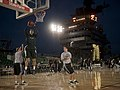 US Navy 111110-N-DR144-737 Michigan State University basketball player Alex Gauna dunks during a practice in the basketball arena on the flight dec.jpg