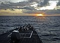 US Navy 111111-N-RI884-016 The guided-missile destroyer USS O'Kane (DDG 77) performs maneuvers during sunrise as part of the integrated maritime ex.jpg
