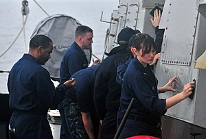 US Navy 120124-N-OP638-017 Sailors scrub the bulkhead during an all-hands preservation call aboard the Arleigh Burke-class guided-missile destroyer.jpg