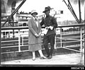 Uniformed man possibly from a military band and a woman on board the ship WELLINGTON, 1920-1935 (8159541365).jpg