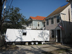 FEMA trailer - A FEMA trailer (travel trailer) in front of a formerly flooded house in New Orleans.