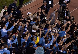 Uruguay players with CA trophy.jpg